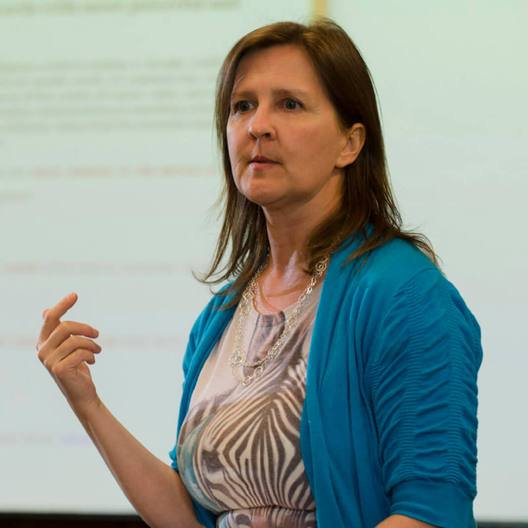 A woman presents a lecture