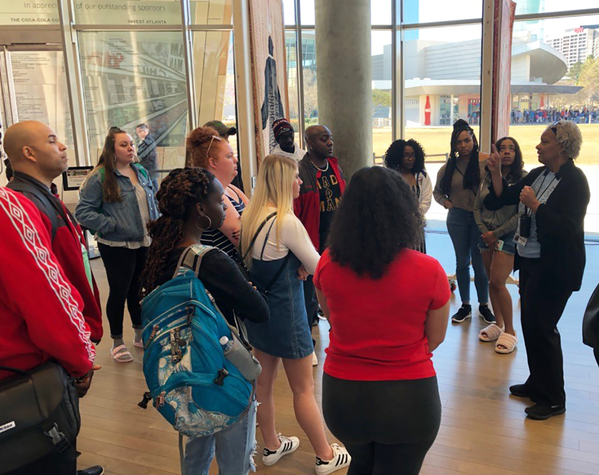Students listen to a museum guide