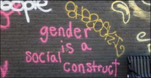 "graffiti that reads ""gender is a social construct"""
