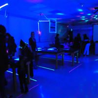 Science classroom illuminated by black light