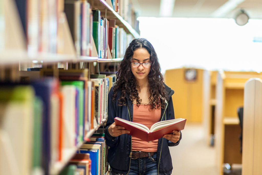Picture: Student reading a book in the library