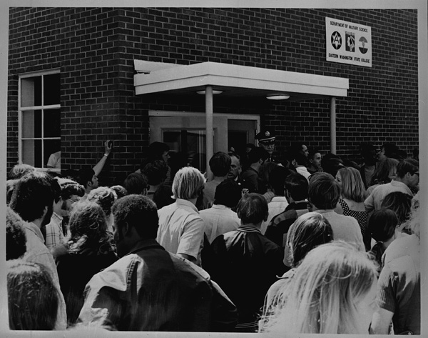 Image of demonstrators gathered near the entrance of Cadet Hall the day after the Kent State shooting